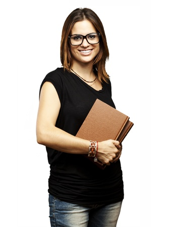 portrait of young student with glasses holding a old book over white background Stock Photo - 11506354