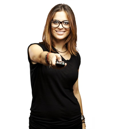changing channel: portrait of young woman with glasses changing channel over white background Stock Photo