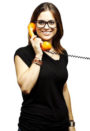 portrait of young woman talking using vintage telephone over white background photo