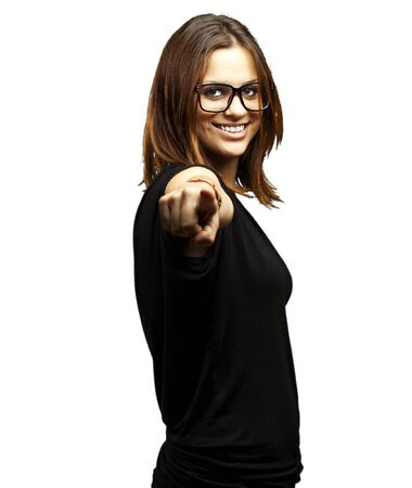 portrait of young woman pointing with glasses over white background Stock Photo - 11506139
