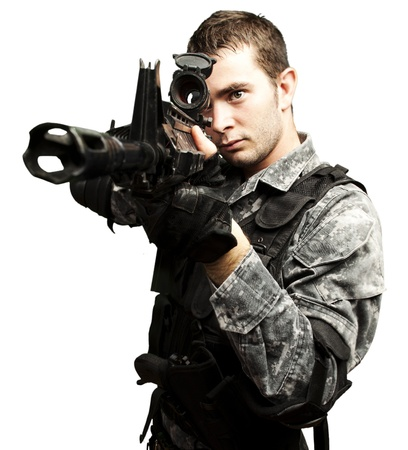 man holding gun: portrait of young soldier aiming with rifle over white background
