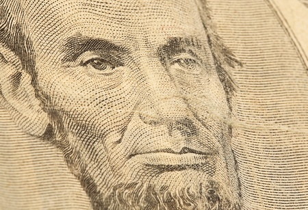 abraham: abraham lincoln face on 5 dollars note