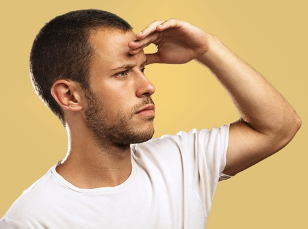 young man looking forward to the future on beige background photo