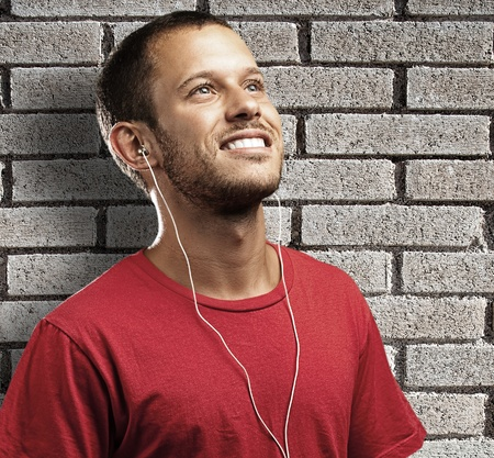 young man listen to music against a grunge background photo