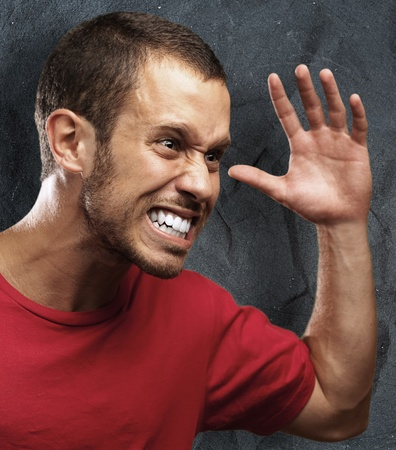 angry young man against a grunge background Stock Photo - 11506588