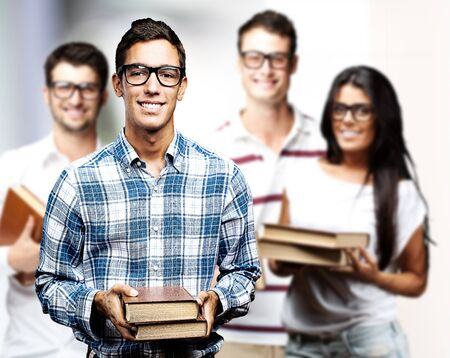 portrait of young students group with books indoor  photo