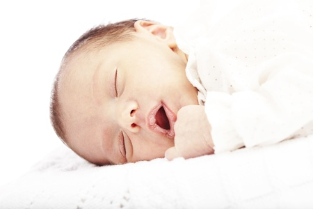 portrait of newborn baby sleeping in a bed ober white background Stock Photo - 11506350