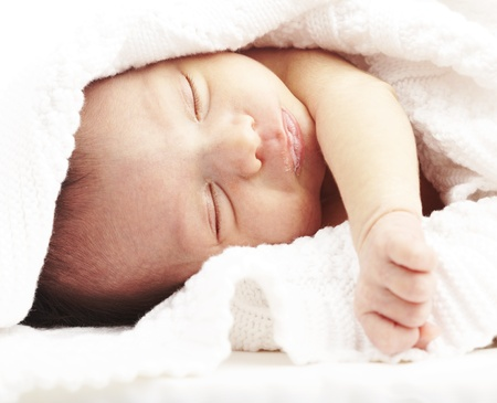 portrait of newborn baby sleeping on a bed under a towel Stock Photo - 11506406