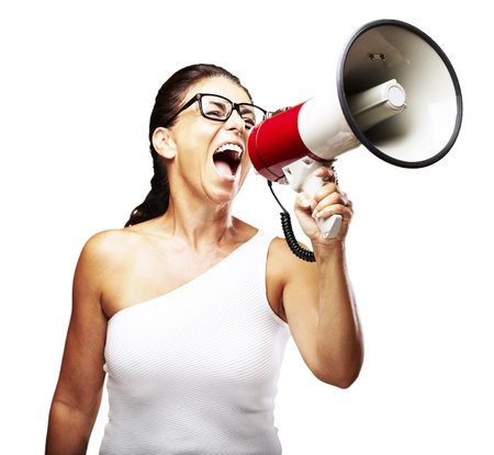 portrait of middle aged woman shouting using megaphone over white background Stock Photo - 11506108