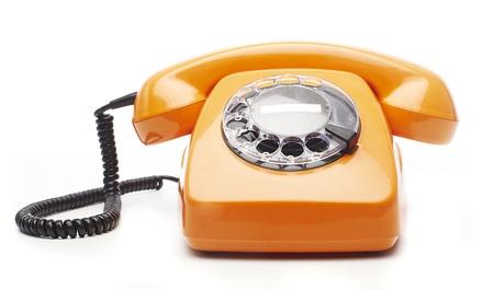 telephone receiver: vintage orange telephone isolated over white background