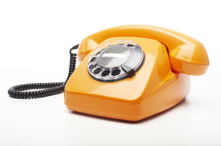phone number: vintage orange telephone isolated over white background