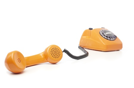 old phone: vintage orange telephone isolated over white background