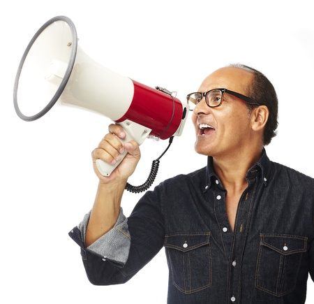 portrait of middle aged man shouting with megaphone over white background photo