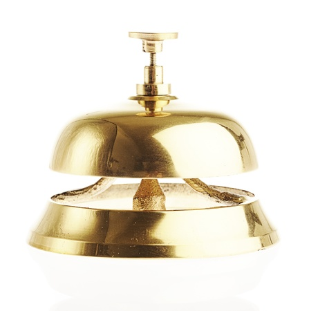 golden bell isolated against a white background photo