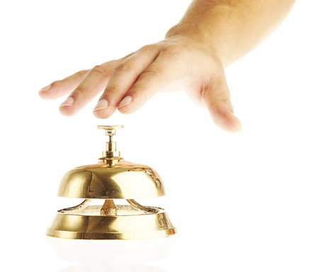 hotel recepcionist pressing a golden bell over white background photo
