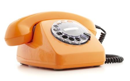 orange vintage telephone isolated on white photo