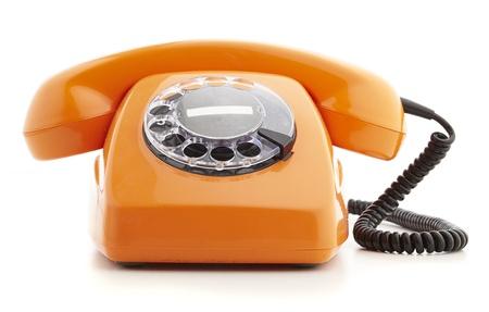 telefono antico: telefono arancione d'epoca isolato su bianco Archivio Fotografico