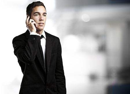 house call: portrait of business man talking on mobile indoor
