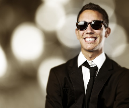 night shirt: portrait of business man with sunglasses laughing against a abstract background