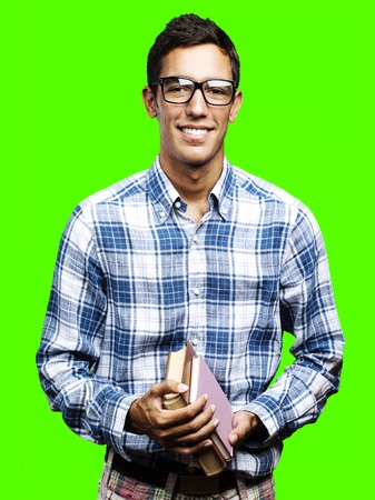 portrait of young man holding books pile against a removable chroma key background Stock Photo - 11507582