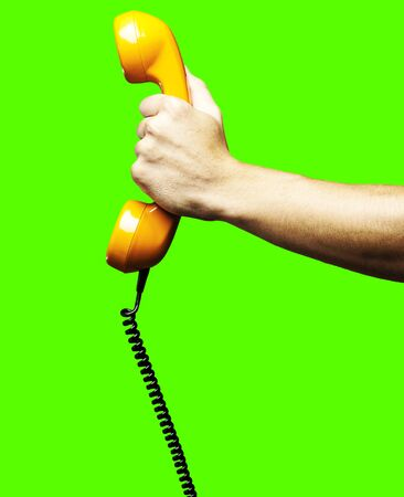man giving a vintage telephone against a removable chroma key background photo