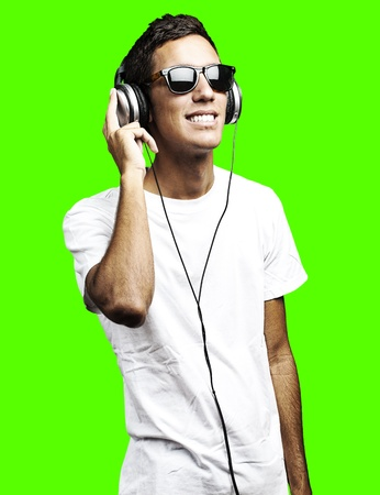 removable: portrait of young man listening to music against a removable chroma key background