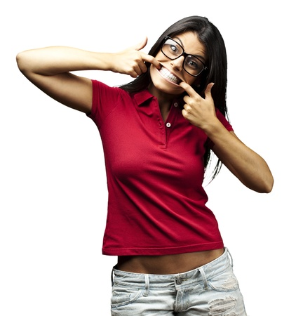 portrait of happy young woman doing a grimace over white background Stock Photo - 11507467