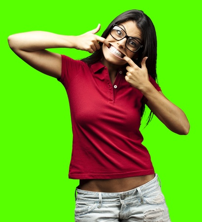 joking: portrait of young woman joking against a removable chroma key background Stock Photo
