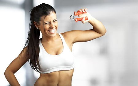 portrait of a pretty sporty woman training indoor photo