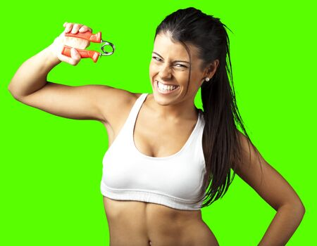 physical fitness: portrait of sporty young woman training against a removable chroma key background Stock Photo