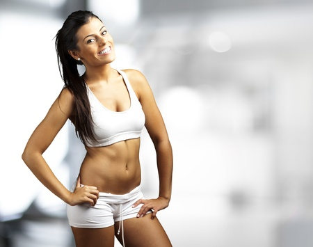 portrait of a pretty sporty woman indoor Stock Photo - 11507226
