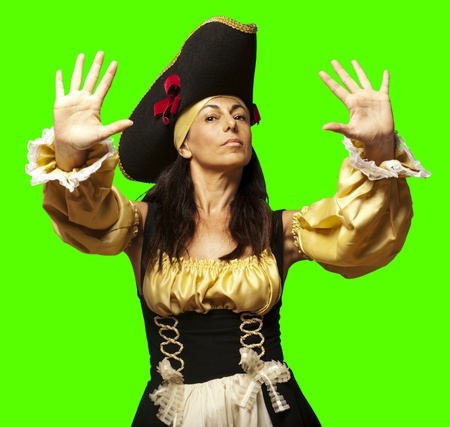 portrait of pirate woman gesturing stop against a removable chroma key background photo