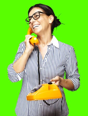 portrait of a middle aged woman talking against a removable chroma key background Stock Photo - 11507193