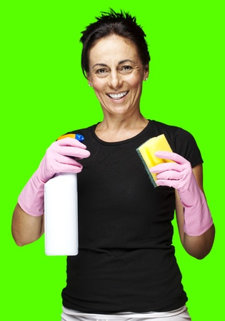 portrait of a middle aged woman cleaning against a removable chroma key background photo