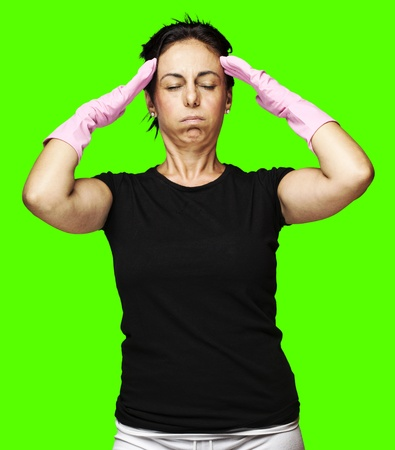 portrait of a middle aged woman tired against a removable chroma key background photo