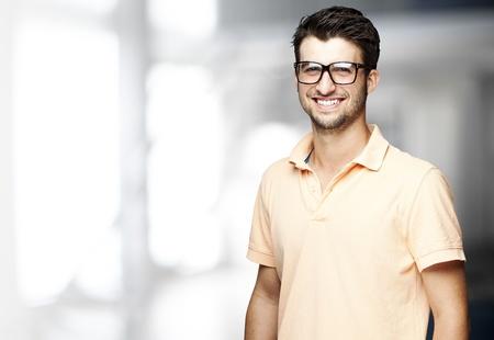 happy man: portrait of a handsome happy man indoor