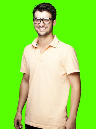 portrait of young man smiling against a removable chroma key background photo