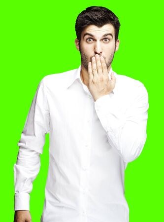 no mistake: portrait of young man surprised against a removable chroma key background Stock Photo