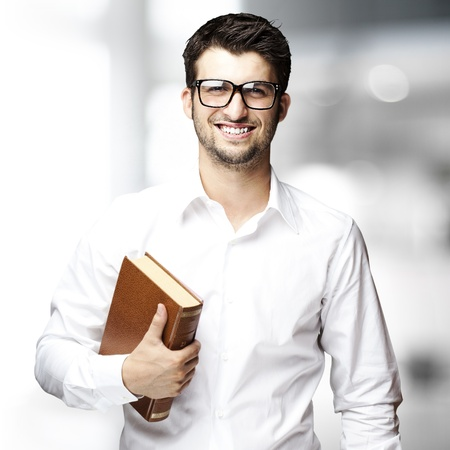 portrait of young student holding book indoor photo
