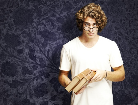 portrait of young student holding books against a vintage wall Stock Photo - 11507407