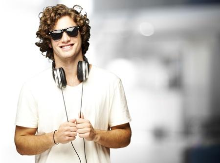 home audio: portrait of young man smiling with headphones indoor