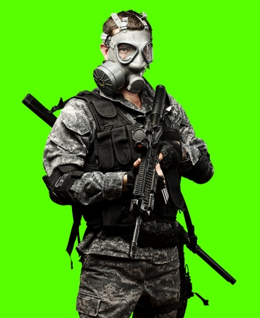 portrait of full armed young soldier against a removable chroma key background photo