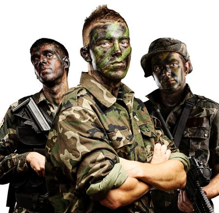 portrait of soldiers group with jungle camouflage over white photo