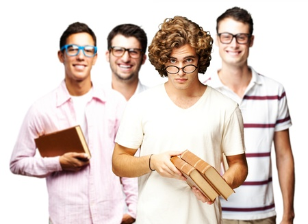 portrait of a group of students holding books over white background photo