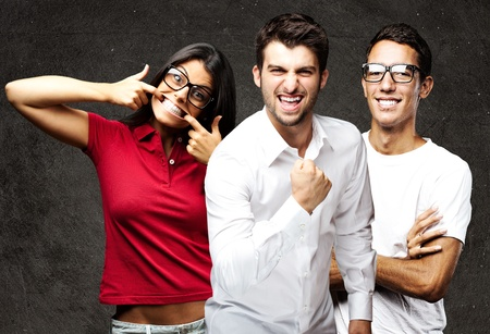 portrait of student´s group smiling and joking against a grunge background Stock Photo - 11507585