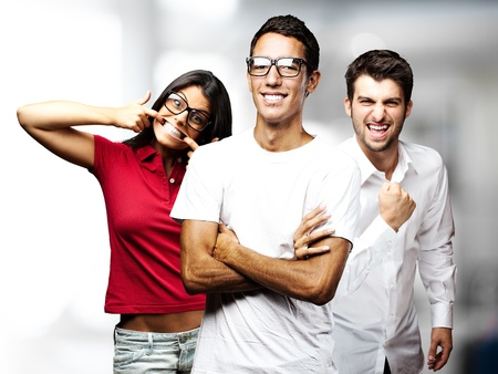 joking: portrait of student´s group smiling and joking over white background
