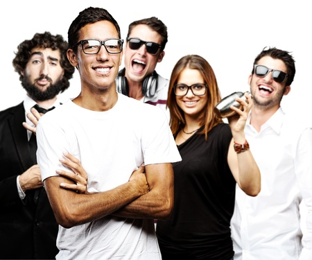 joking: portrait of student´s group smiling and joking against a white background Stock Photo