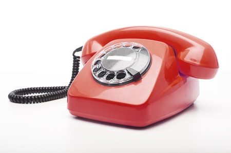 vintage red telephone isolated over white background photo