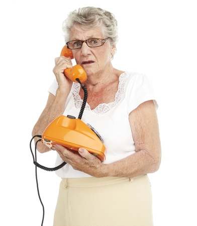 portrait of a happy senior woman talking on telephone over white background Stock Photo - 11507416