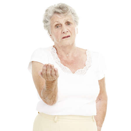 portrait of senior woman gesturing offer with hand over white background photo